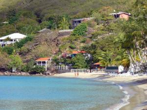 Landscapes of Martinique - Houses overlooking the beach of Grande Anse d'Arlet and the Caribbean Sea; in the town of Anse d'Arlet