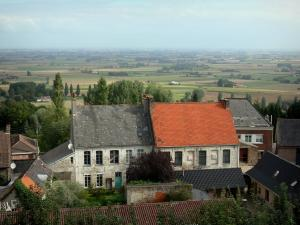 Landscapes of the Nord - From the Cassel mountain, view of the roofs of the houses of the Cassel city, trees and the Flanders plain