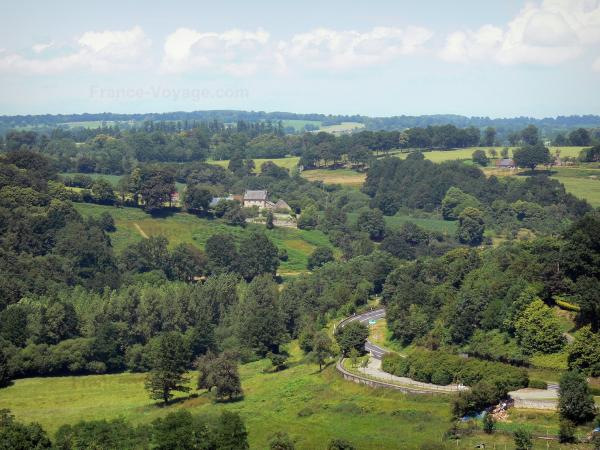 Landscapes of the Orne - Wooded landscape dotted with fields and houses; in Domfrontais