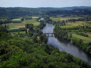 Landscapes of Périgord - Dordogne valley: trees, bridge spanning the River Dordogne, fields and hills