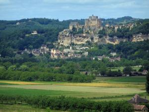 Landscapes of Périgord - Village of Beynac-et-Cazenac, with its hilltop castle, its cliff and its houses, trees and fields, in the Dordogne valley
