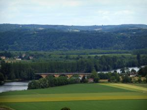 Landscapes of Périgord - Dordogne valley: fields, bridge spanning the River Dordogne, trees along the water and hills