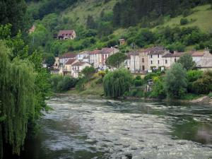 Landscapes of Périgord - Vézère river, houses of the city of Bugue and trees along the water