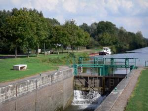 Landscapes of Picardy - Lock of the Somme canal, moored boat, trees along the water