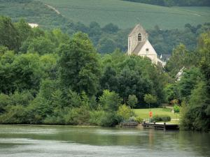 Landscapes of Picardy - Marne valley: Gothic church of Mézy-Mills, Marne river, bank planted with trees, vines of the Champagne vineyards in the background