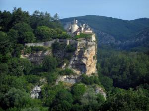 Landscapes of the Quercy - Belcastel castle perched on its cliff, trees and forest, in the Dordogne valley