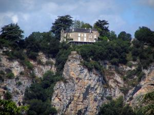 Landscapes of the Quercy - Perched residence, trees, cliffs and cloudy sky