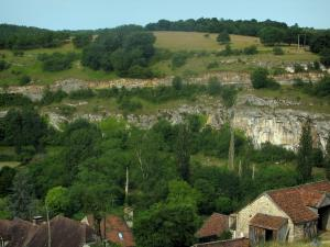 Landscapes of the Quercy - Roofs of houses, trees, rock faces and meadow