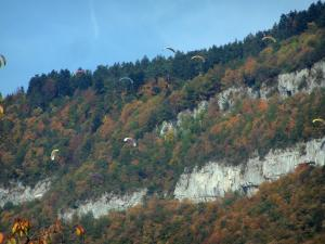 Landscapes of the Savoie in automn - Paraglides and mountain covered with trees in autumn