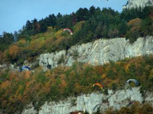 Landscapes of the Savoie in automn - Paraglides, cliff and trees in autumn