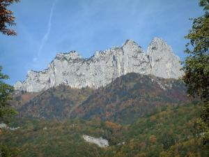 Landscapes of the Savoie in automn - Hills covered with forests in autumn and dents de Lanfon cliffs overhanging Lake Annecy