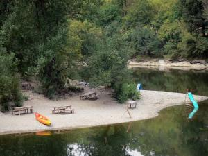 Landscapes of the Tarn-et-Garonne - Aveyron gorges: River Aveyron, trees along the water and bank with picnic tables