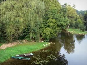 Landscapes of the Vienne - Anglin river, boats, bank, trees along the water; in Angles-sur-l'Anglin