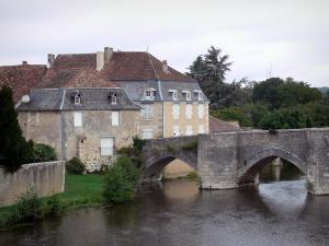 Landscapes of the Vienne - Ancient bridge spanning the River Gartempe, trees and houses of the village of Saint-Savin