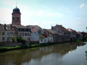 Landscapes of the Vosges - Church and houses of a village on the edge of a river