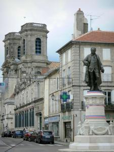 Langres - Statue of Denis Diderot (artwork by Frederic Bartholdi), towers of the Saint-Mammès cathedral and houses in the old town