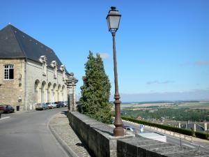 Laon - Walk along the ramparts with a view of the plain and the Arts and Recreation centre (Maison des Arts et Loisirs) of Laon; lamppost in the foreground