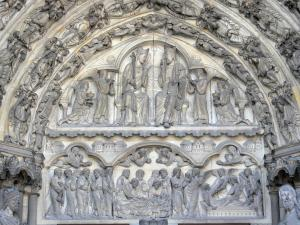 Laon - Notre-Dame cathedral of Gothic style: carved tympanum of the central portal of the west facade