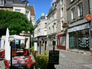 Laon - Cafe terrace and facades of houses in the medieval town