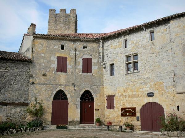 Larressingle - Crenellated tower and facades of houses in the fortified medieval village