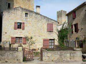 Larressingle - Crenellated tower and facade of stone houses in the fortified medieval village