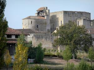 Larressingle - View of the fortified Romanesque church (Saint-Sigismond church) and the keep-castle
