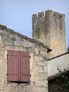 Larressingle - Facade of a stone house and crenellated tower