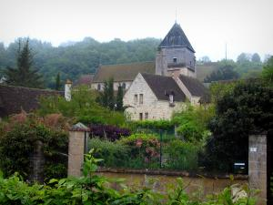 Lavardin - Saint-Genest church of Romanesque style, houses of the village and trees