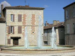 Lectoure - Pond with fountains and facades of houses in the old town; in the Gers Lomagne
