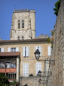 Lectoure - Bell tower of the Saint-Gervais-Saint-Protais cathedral, facade of Town Hall (former episcopal palace) and wall lanterns; in the Gers Lomagne