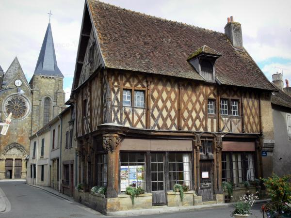 Levroux - Wooden house (Gothic house with wood sides) and collegiate church of Saint-Sylvain in background