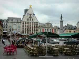 Lille - Café terraces of the Grand'Place square (General de Gaulle square), the Déesse column, the Voix du Nord building, the Grand'Garde (building home to the North theatre) and houses