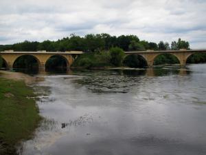 Limeuil - Bank, confluence of the Dordogne and the Vézère rivers, bridges, trees and cloudy sky, in Périgord