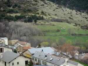 Llo - View over the roofs of the village and the surrounding landscape, in the heart of Cerdagne, in the Regional Natural Park of the Catalan Pyrenees