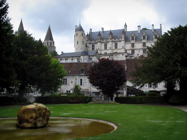 Loches - From the public garden (lake, lawn and trees), view of the royal residence, the towers of the Saint-Ours collegiate church and the houses of the city