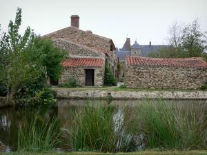 Logis de la Chabotterie manor house - Lake, outbuildings and lodge in background