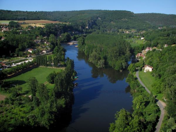 Lot valley - The River Lot, trees along the water, houses, fields, forests and hills, in the Quercy