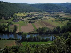 Lot valley - The River Lot, trees along the water, fields, houses, forests and hills, in the Quercy