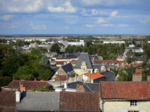 Loudun - View of the roofs of the city, trees and surrounding countryside, clouds in the sky
