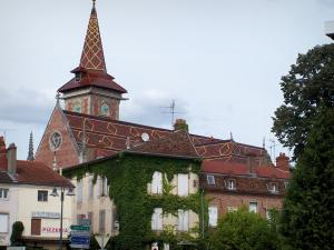 Louhans - Saint-Pierre church with its varnished tiles on the roof and houses of the city