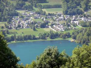 Louron valley - Génos-Loudenvielle lake surrounded by trees and the village of Génos