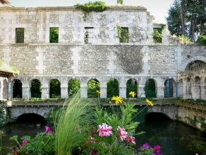 Louviers - Cloister of the old convent of the Penitents (cloister of the Penitents) on River Eure, flowers in the foreground