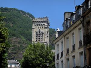 Luchon - Facades of houses and church bell tower in the spa town