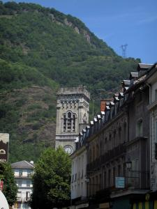 Luchon - Church bell tower, facades of houses in the spa town and mountain dominating the set
