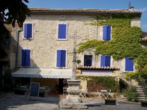 Lussan - Stone house with blue shutters, restaurant terrace and calvary