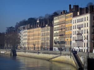 Lyon - Houses with colourful facades with the Saint Vincent quay and the Saône river