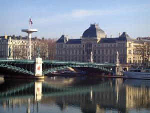 Lyon - The Université bridge, the Rhone river, boat and buildings