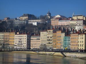 Lyon - Houses with colourful facades, the Saint Vincent quay, and the Saône river