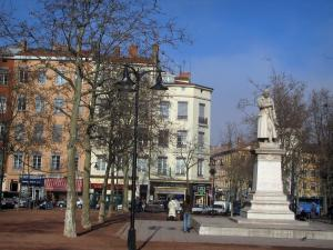 Lyon - Croix-Rousse: Croix-Rousse square with the Jacquard statue, trees and houses