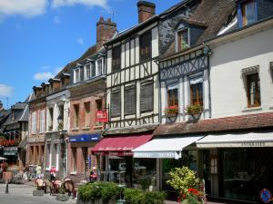 Lyons-la-Forêt - Facades of houses, café terrace and shops of the village